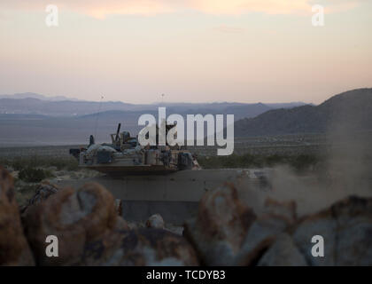 A section of Oregon Army National Guard, M1A2 Abrams Main Battle Tanks, 3rd Battalion, 116th Cavalry Regimen, 116th Cavalry Brigade Team peruses enemy forces after a simulated attack during an exercise at the National Training Center, Fort Irwin, California, June, 5, 2019. The NTC serves as the Army's premiere training center. (U.S. Air National Guard photo by Senior Airman Mercedee Wilds) - Stock Photo