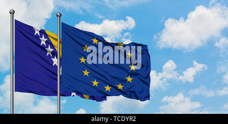 Bosnia Herzegovina and European Union flag waving in the wind against white cloudy blue sky together. Diplomacy concept, international relations. - Stock Photo