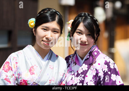 Japanese Woman Dressed in Kimono - Stock Photo