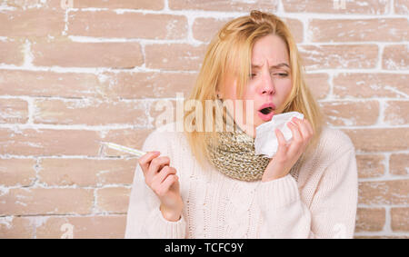 High temperature concept. Woman feels badly ill. How to bring fever down. Fever symptoms and causes. Sick girl with fever. Girl hold thermometer and tissue. Measure temperature. Break fever remedies. - Stock Photo