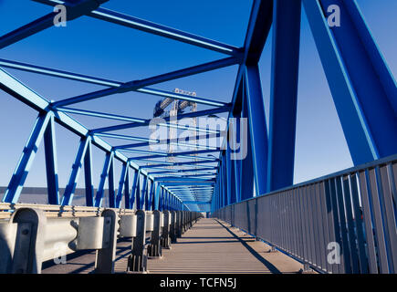 modern bridge construction and road going through the bridge - Stock Photo