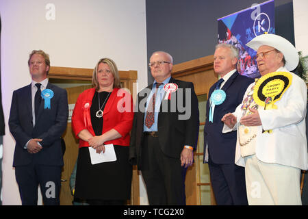 Peterborough, UK. 07th June, 2019. Candidates wait for the results before Lisa Forbes (Labour Party Candidate) has became the  new Member of Parliament for Peterborough, beating Mike Greene (Brexit Party candidate, 2nd right) into second place and Paul Bristow (Conservative Party candidate, left) was third. The by-election was held in Peterborough today after disgraced MP Fiona Onasanya was removed from her post as Peterborough MP when over 19,000 signed a recall petition, following her court appearance over a speeding ticket, and her spell in jail. Peterborough by-election, Peterborough, Camb - Stock Photo