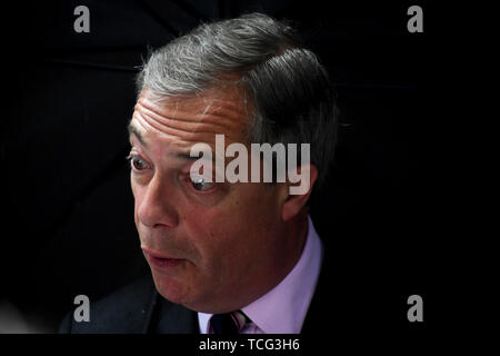 London, UK. 07th June, 2019. Nigel Farage of the Brexit Party talks to the media after handing in a letter to 10 Downing Street asking for the Brexit Party to be included in Brexit negotiations, in London, Britain, on June 7, 2019. Britain's main opposition Labour Party Friday held onto a parliamentary seat in a by-election in marginal Peterborough constituency, but the newly established Brexit Party was not far behind. It was the first assault on Westminster politics by the newly established Brexit Party, launched earlier this year by veteran Eurosceptic Nigel Farage. Credit: Xinhua/Alamy Liv - Stock Photo
