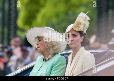 London, UK. 8th June, 2019. Kate and Camilla The Duchesses of Cambridge and Cornwall ride on an open top carriage along The Mall during the Queen's Birthday parade Credit: amer ghazzal/Alamy Live News - Stock Photo