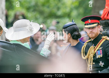 London, UK. 8th June, 2019. Her Majesty Queen Elizabeth II passes in a carriage along The Mall for Trooping the Colour ceremony at Horse Guards parade 8th June 2019. Meghan and Harry, The Duke and Duchess of Sussex ride on an open top carriage along The Mall during the Queen's Birthday parade Credit: amer ghazzal/Alamy Live News - Stock Photo