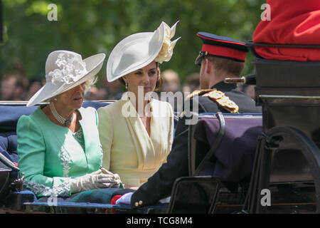 London UK. 8th June 2019. Camilla Duchess of Cornwall and Kate Duchess  of Cambridge ride in an open top  carriage  facing Prince Harry  along The Mall  after returning Trooping the Colour ceremony at Horse Guards parade to celebrate Her Majesty Queen Elizabeth II official 93rd birthday - Stock Photo