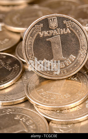 Large pile of big golden coins. Financial success money background for rich life concepts, banking and profit in Ukraine - Stock Photo