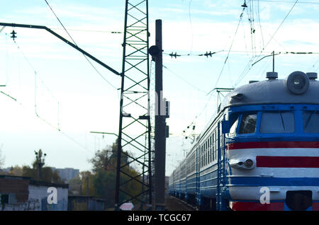Suburban electric train. Old soviet electric train with outdated design moving by rail. Transportation concept - Stock Photo