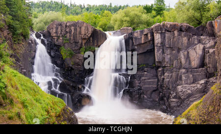 High Falls at US/Canadian border at Grand Portage State Park Minnesota - Stock Photo