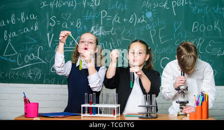 Little children at school lesson. students doing experiments with microscope. happy childrens day. Chemistry. Back to school. Little kids learning chemistry in school lab.What seems to be a problem - Stock Photo