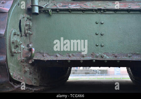 Abstract green industrial metal textured background with rivets and bolts. Old painted metal backdrop, detail of military tank surface corrosion, meta - Stock Photo