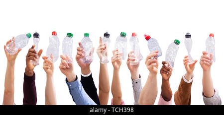 Group Of People's Hand Holding Crushed Water Bottles Against Isolated On White Background