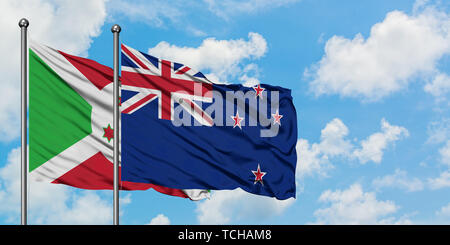 Burundi and New Zealand flag waving in the wind against white cloudy blue sky together. Diplomacy concept, international relations. - Stock Photo