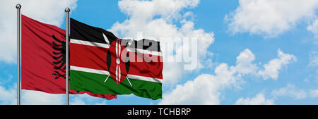 Albania and Kenya flag waving in the wind against white cloudy blue sky together. Diplomacy concept, international relations. - Stock Photo