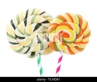 Colorful lollipops with ribbons isolated on white - Stock Photo