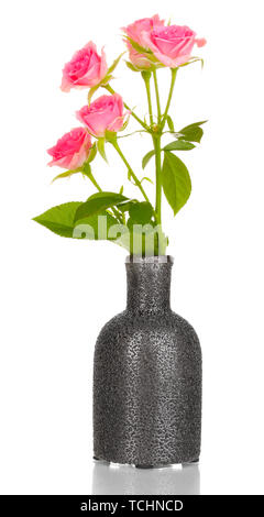 Pink roses in vase isolated on white - Stock Photo