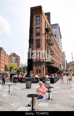 The street view of meatpacking district with the Herring Safe & Lock Company Building at 9 Avenue and Hudson Street at 14th street.New York City.USA - Stock Photo
