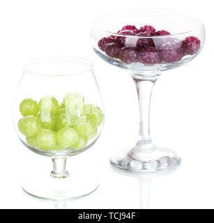 Color candies in glasses isolated on white - Stock Photo