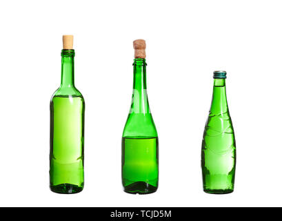 Three empty unlabeled bottles isolated on white background - Stock Photo