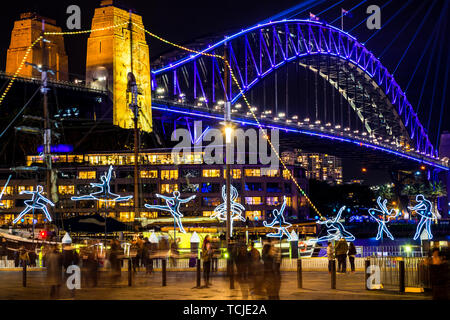 The Sydney Harbour Bridge at night viewed from the Rocks area during the annual light festival Vivid. - Stock Photo