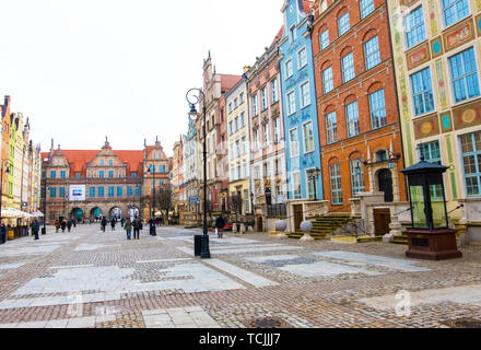 Gdansk, Poland - February 07, 2019: Long Market Street, typical decorative medieval tenement houses, Royal Route in Gdansk, Poland - Stock Photo