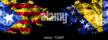 Catalonia vs Bosnia and Herzegovina, Bosnian smoke flags placed side by side. Thick colored silky smoke flags of Catalonia and Bosnia and Herzegovina, - Stock Photo