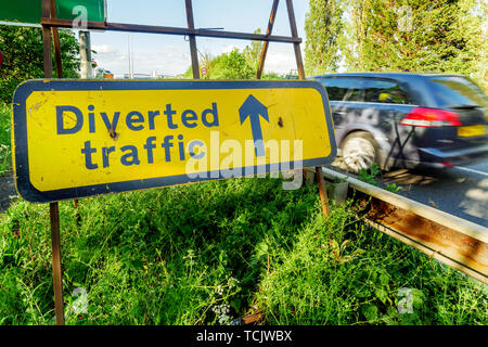 Diverted traffic sign on UK motorway in England. - Stock Photo