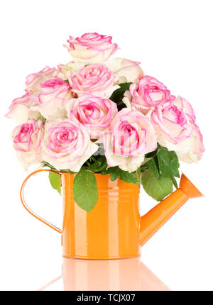 beautiful bouquet of pink roses in watering can, isolated on white - Stock Photo