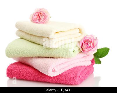 bright towels and roses isolated on white - Stock Photo