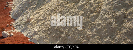 quartz sand and minium in the warehouse of raw materials, cement production. Web banner for your design. - Stock Photo