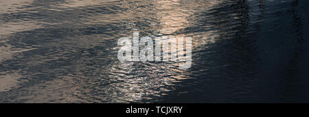 waves on the surface of the water in the river and sun glare. Web banner for your design. - Stock Photo