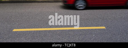 car on an asphalt road and a yellow horizontal line. Web banner for your design. - Stock Photo