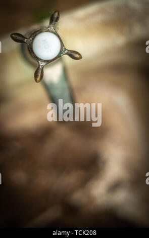 Still Life Of An Old Bath Tap Or Faucet In An Abandoned House Or Apartment - Stock Photo