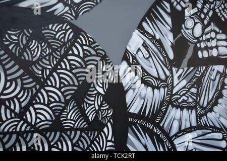 Abstract graffiti paintings on the concrete wall background - Stock Photo