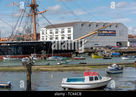 Portsmouth Harbour, England, UK, May 2019. The bow of HMS Warrior at the entrance to Portsmouth Historic Dockyard. - Stock Photo
