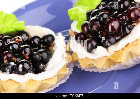 sweet cakes with berries on saucer close-up - Stock Photo