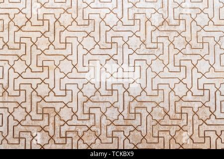 Geometric Moorish plaster decorations, Nazarite palaces, Alhambra, Granada, Andalusia, Spain - Stock Photo