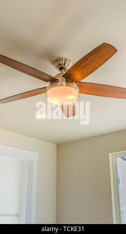 Panorama Ceiling fan with wooden five blade design and built in light - Stock Photo