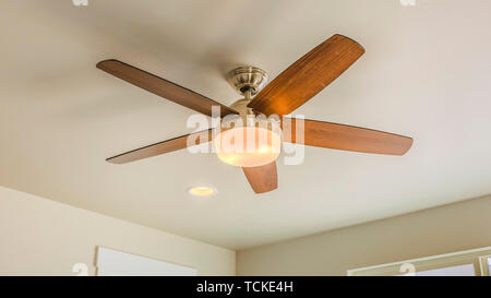 Panorama frame Ceiling fan with wooden five blade design and built in light - Stock Photo