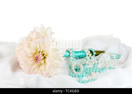 Wedding bouquet of white dahlias and a box on white chiffon close-up - Stock Photo