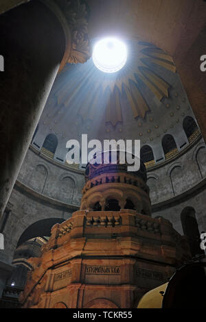 Ray of sunlight breaks through the ceiling over the Edicule, the shrine that tradition says houses the cave where Jesus was entombed and resurrected, at the Church of the Holy Sepulchre in the Christian Quarter old city East Jerusalem Israel - Stock Photo