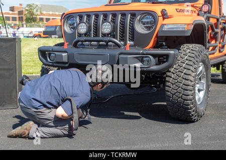 Detroit, Michigan - A photographer inspects a Jeep Gladiator Gravity concept vehicle on display at a community celebration marking the beginning of co - Stock Photo