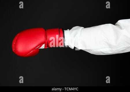 hand in boxing glove isolated on black - Stock Photo