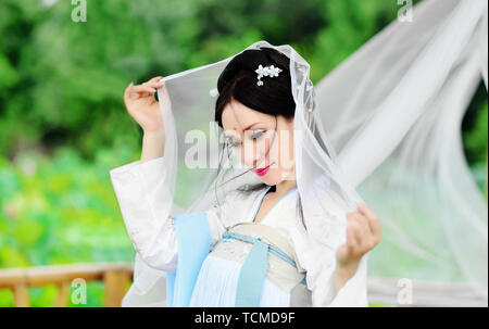 A beautiful Asian woman in the open air,portraits