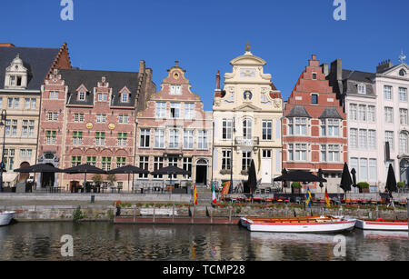 old colorful traditional houses along the canal and boats in popular touristic destination Ghent, Belgium - Stock Photo