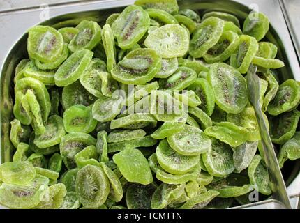 Rich and healthy slices of dried kiwi in the market