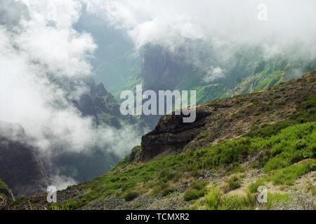 View down from mountain peak. Pico do Arieiro on Portuguese island of Madeira - Stock Photo