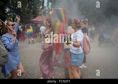 Warsaw, Poland. 08th June, 2019. People covered in smoke during the Warsaw Pride. The Equality March also called the Warsaw Pride parade, brought thousands of people to the streets of Warsaw, at the time when the gay rights movement in Poland is under siege by hate speech and a government campaign depicting it as a threat to families and society. Credit: SOPA Images Limited/Alamy Live News - Stock Photo