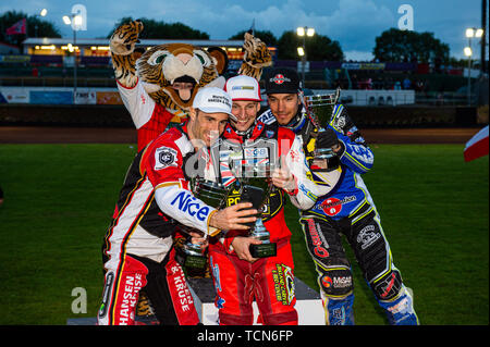 Glasgow, Scotland, UK. 08th June, 2019.  Top 3 take a selfie: Niels-Kristian Iversen (2nd), Craig Cook (1st), Pontus Aspgren (3rd) with Glasgow Mascot Roary (Rear) during the FIM Speedway Grand Prix World Championship - Qualifying Round 1 at the Peugeot Ashfield Stadium, Glasgow on Saturday 8th June 2019. (Credit: Ian Charles | MI News) Credit: MI News & Sport /Alamy Live News - Stock Photo
