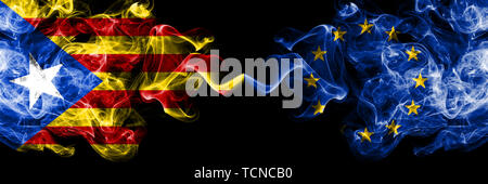 Catalonia vs European Union, EU smoke flags placed side by side. Thick colored silky smoke flags of Catalonia and European Union, EU - Stock Photo